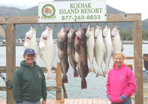 Mike Dunham and Karen King from St. Croix show off their first day's halibut and ling cod catch.