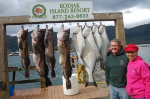 Mike Dunham and Karen King stand in front of their limits of halibut and ling cod.
